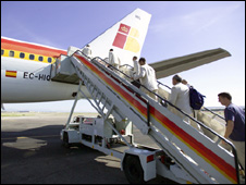 Passengers board an Iberia plane